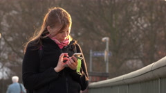 Young female using smart phone to look up information panning shot 4k Stock Footage