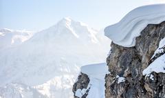 Winter mountain top with big snow cap - stock photo
