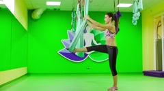 Aerial Yoga  in the air. It is practiced on a soft fabric trapeze Stock Footage