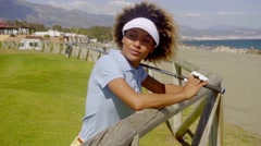 Young woman player on a seafront golf course Stock Footage
