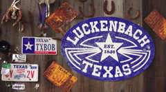 Luckenbach, Texas Sign and Memorabilia on Side of Wooden Barn Stock Footage