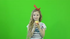 Chromakey footage girl eating an apple on a green background UHD 4K - stock footage