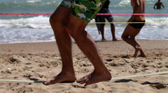 The guy has been Slacklining on the beach Stock Footage