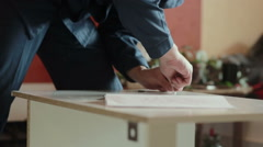 Male worker assembles parts of furniture Stock Footage