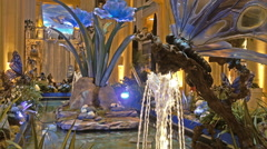Beautiful Indoor fountain, glass dragonflies and flowers Stock Footage