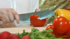 Man preparing vegetable salad slices tomato. Stock Footage