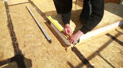 a man building a house. foam polystyrene. blocks made of plywood and insulation - stock footage