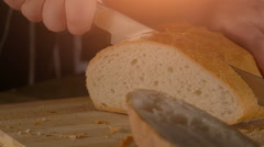 Slicing Wholegrain Bread in slow motion Stock Footage