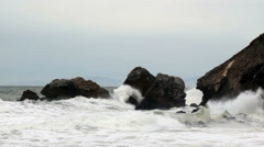 Slow Motion Ocean Waves Hitting Headland Rocks - stock footage
