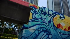 Cool street Art by Collins Ave. in Miami as you drive by Stock Footage