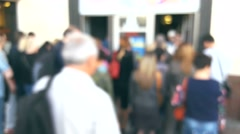 Crowd of people go to the metro station at rush hour, blurred background - stock footage