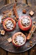 Baked apples stuffed with granola - stock photo