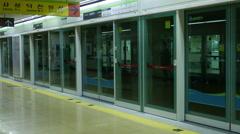 Subway platform screen door in korea Stock Footage