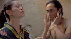 A strange love affair between two mixed ethnic butoh dancers Stock Footage
