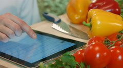 The man on the tablet PC searches for breakfast recipes. - stock footage