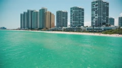 Beautiful pan of ocean and buildings at beach in Miami, Sunny Isles - stock footage