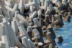 Coastal protection against erosion using concrete tetrapods which absorb the - stock photo