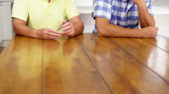 Nervous discussion between a son and his father Stock Footage
