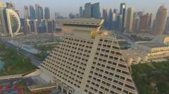 Flight over the five-star hotel Sheraton Doha Hotel & Resort in Qatar Stock Footage
