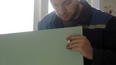 Man assembles furniture using a screwdriver Stock Footage