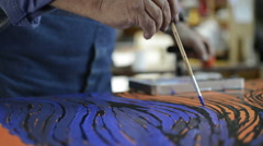 Old man artist painting canvas. Stock Footage