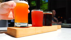 4K Hand Holding Beer Sample Glass, Craft Brewery, 3 Various Types Stock Footage