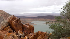 Moroccan landscape with river dam and red rocks Stock Footage