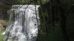 Fly Through Forest Towards Epic Waterfall. Stock Footage