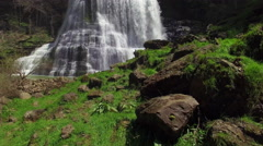 Flying Low Over Grass Towards Epic Waterfall 001 Stock Footage