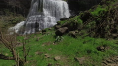 Flying Low Over Grass Towards Epic Waterfall 003 Stock Footage