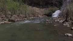 Flying Up River Towards Waterfall Stock Footage