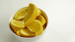 Rotating bowl of sliced oranges. Stock Footage