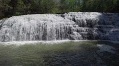 Flying Close Towards Large Cascading Waterfall Stock Footage