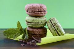Chocolate and mint flavor macarons Stock Photos