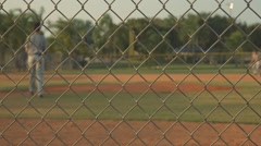 Baseball field shot from behind a fence - stock footage