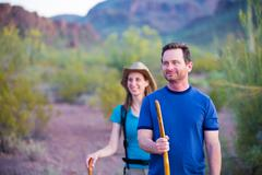 Desert Hikers on Mountain Path - stock photo