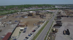 Flying Over Scrap Yard on Sunny Day Stock Footage