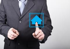 Technology, internet and networking concept - Businessman presses home button on Stock Photos