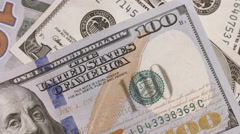Scattered hundred dollars money close up camera motion. Stock Footage