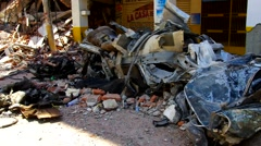 Earthquake aftermath, smashed cars in street - stock footage