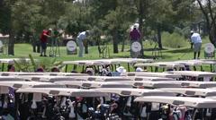 Medium shot, playing golf at golf corse Stock Footage