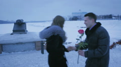 If late, a man gives rose to girl. She angrily throws it Stock Footage