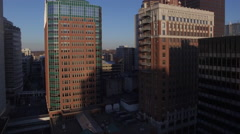 Des Moines Downtown Skyscrapers Sunrise 006 Fly Between Buildings Stock Footage