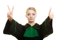Woman barrister making sign victory thumb up gesture - stock photo