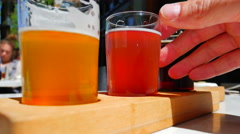 4K Hand on Glass, Craft Beer Tasting Samples on Outside Table at Pub Stock Footage