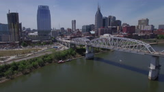 Flying Over Bridge and River Towards Nashville Skyline Stock Footage