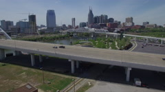 Flying Over Bridge Park and River Towards Nashville Skyline Stock Footage
