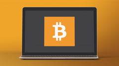 4k - Laptop with bitcoin icon symbol Stock Footage