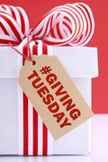 Red and white Giving Tuesday gift. - stock photo