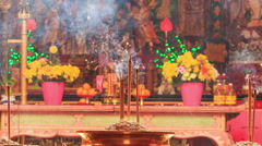 Burning Sticks in Bowls in Front of Altar in Indian Temple - stock footage